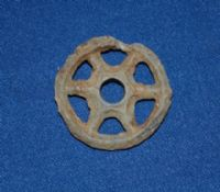 A scarce and unusual lead wheel from a Roman childs pull along toy horse or chariot, London. SOLD